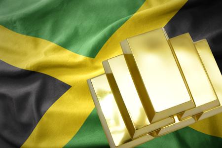 gold reserves. shining golden bullions on the jamaica flag background