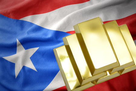 gold reserves. shining golden bullions on the puerto rico flag background