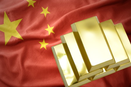 gold reserves. shining golden bullions on the china flag background