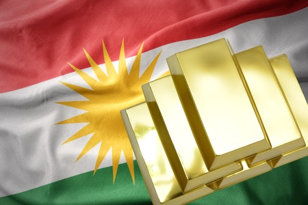 mideast: gold reserves. shining golden bullions on the kurdistan flag background