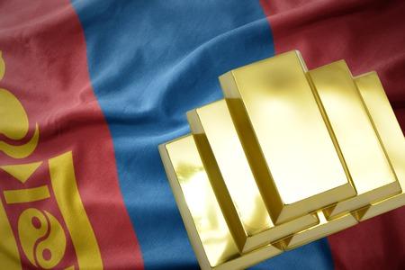 mideast: gold reserves. shining golden bullions on the mongolia flag background