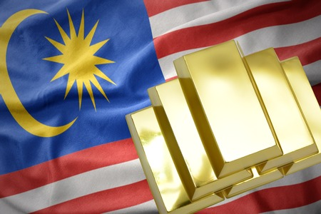 mideast: gold reserves. shining golden bullions on the malaysia flag background