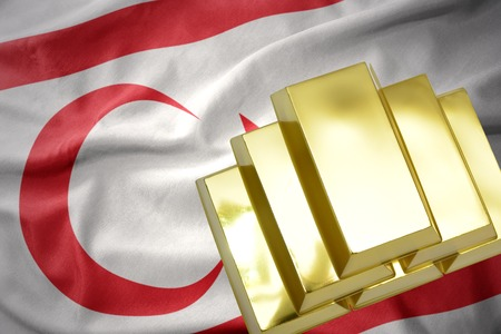 gold reserves. shining golden bullions on the northern cyprus flag background