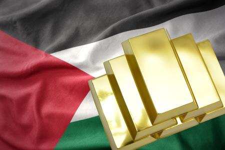mideast: gold reserves. shining golden bullions on the palestine flag background Stock Photo