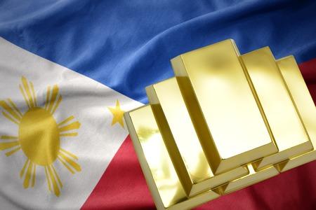mideast: gold reserves. shining golden bullions on the philippines flag background