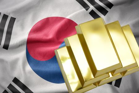 mideast: gold reserves. shining golden bullions on the south korea flag background