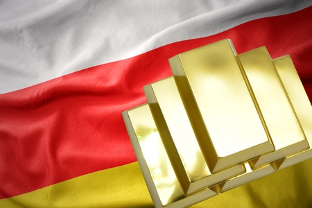 gold reserves. shining golden bullions on the south ossetia flag background