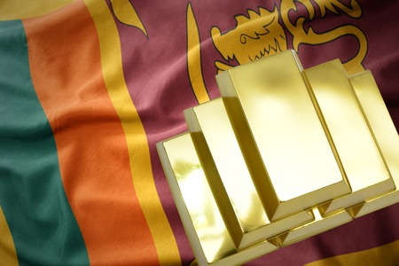 gold reserves. shining golden bullions on the sri lanka flag background