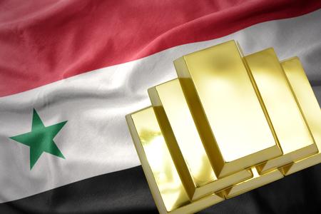 gold reserves. shining golden bullions on the syria flag background Stock Photo