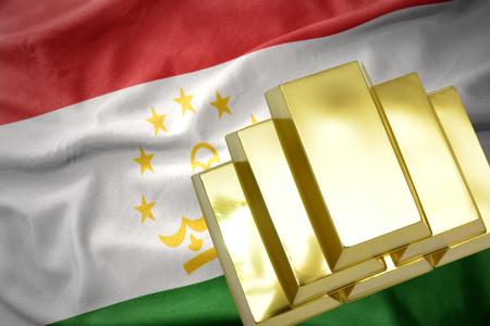 gold reserves. shining golden bullions on the tajikistan flag background