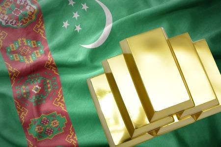 gold reserves. shining golden bullions on the turkmenistan flag background
