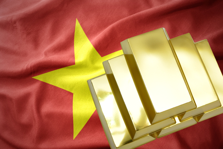 gold reserves. shining golden bullions on the vietnam flag background