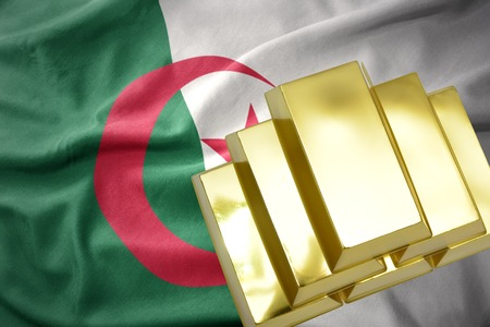 gold reserves. shining golden bullions on the algeria flag background