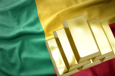 gold reserves. shining golden bullions on the benin flag background