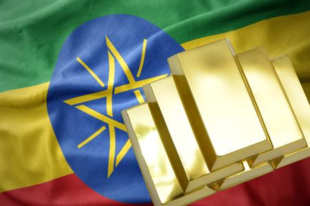 gold reserves. shining golden bullions on the ethiopia flag background Stock Photo