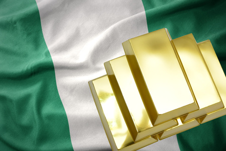 gold reserves. shining golden bullions on the nigeria flag background Stock Photo