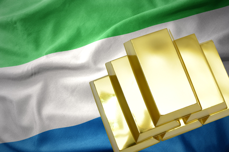concern: gold reserves. shining golden bullions on the sierra leone flag background