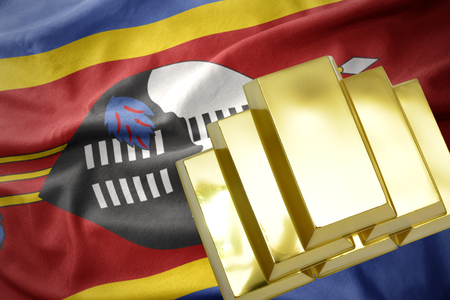 gold reserves. shining golden bullions on the swaziland flag background