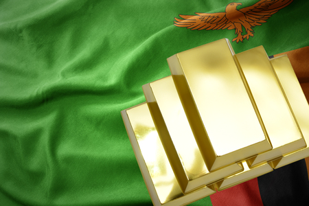 gold reserves. shining golden bullions on the zambia flag background