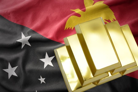 gold reserves. shining golden bullions on the Papua New Guinea flag background Stock Photo