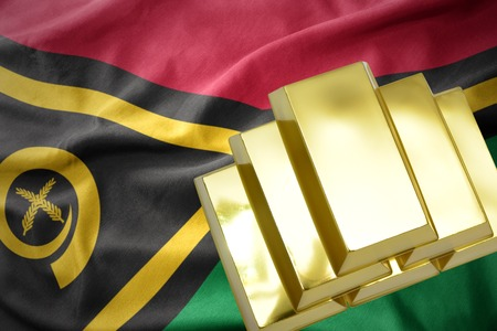 gold reserves. shining golden bullions on the Vanuatu flag background Stock Photo