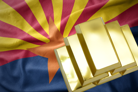 gold reserves. shining golden bullions on the arizona state flag background