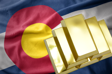 concern: gold reserves. shining golden bullions on the colorado state flag background