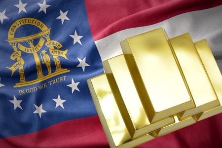 gold reserves. shining golden bullions on the georgia state flag background