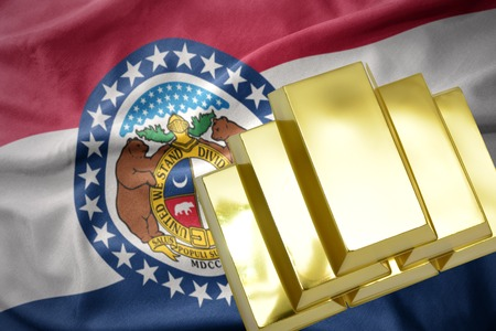 gold reserves. shining golden bullions on the missouri state flag background Stock Photo