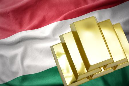 gold reserves. shining golden bullions on the hungary flag background.3D illustration