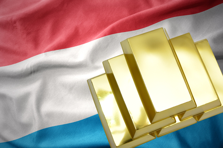 gold reserves. shining golden bullions on the luxembourg flag background.3D illustration