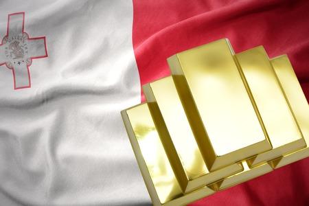 gold reserves. shining golden bullions on the malta flag background.3D illustration Stock Photo