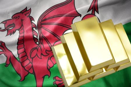 gold reserves. shining golden bullions on the wales flag background.3D illustration Stock Photo