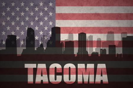 tacoma: abstract silhouette of the city with text Tacoma at the vintage american flag background