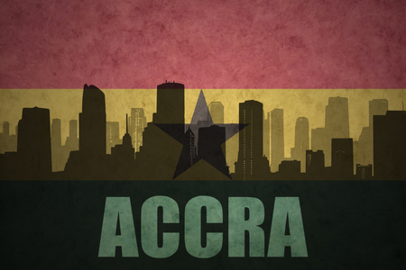 abstract silhouette of the city with text Accra at the vintage ghanaian flag background
