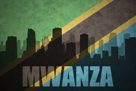 abstract silhouette of the city with text Mwanza at the vintage tanzanian flag background