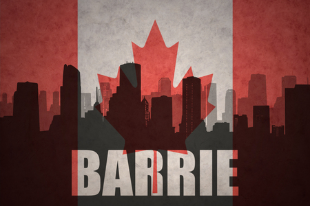 barrie: abstract silhouette of the city with text Barrie at the vintage canadian flag background