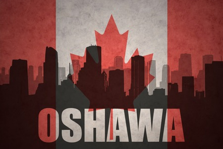 abstract silhouette of the city with text Oshawa at the vintage canadian flag background