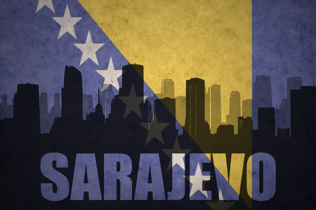 abstract silhouette of the city with text Sarajevo at the vintage bosnian flag background