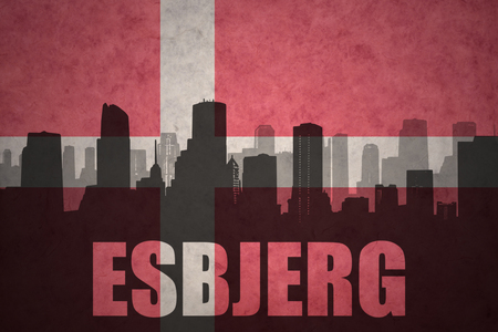 esbjerg: abstract silhouette of the city with text Esbjerg at the vintage danish flag background Stock Photo