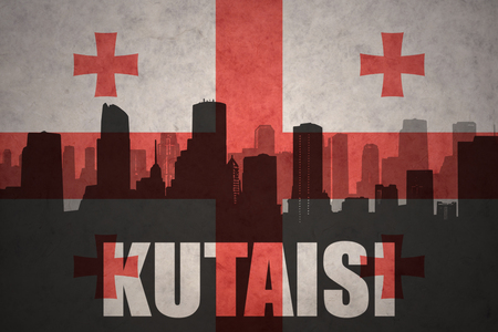 kutaisi: abstract silhouette of the city with text Kutaisi at the vintage georgian flag background