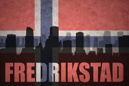 abstract silhouette of the city with text Fredrikstad at the vintage norwegian flag background