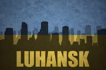 luhansk: abstract silhouette of the city with text Luhansk at the vintage ukrainian flag background Stock Photo
