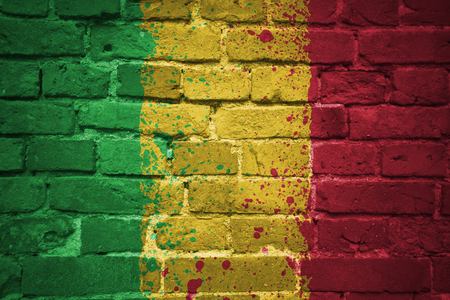 colorful painted national flag of mali on a old brick wall
