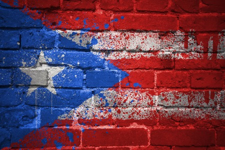 colorful painted national flag of puerto rico on a old brick wall Stock Photo