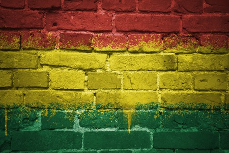 colorful painted national flag of bolivia on a old brick wall Stock Photo