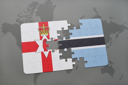 belfast: puzzle with the national flag of northern ireland and botswana on a world map background. 3D illustration Stock Photo