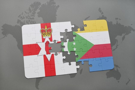 northern ireland: puzzle with the national flag of northern ireland and comoros on a world map background. 3D illustration
