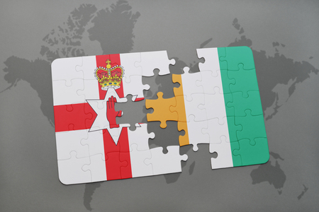 belfast: puzzle with the national flag of northern ireland and cote divoire on a world map background. 3D illustration