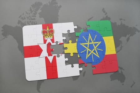 belfast: puzzle with the national flag of northern ireland and ethiopia on a world map background. 3D illustration
